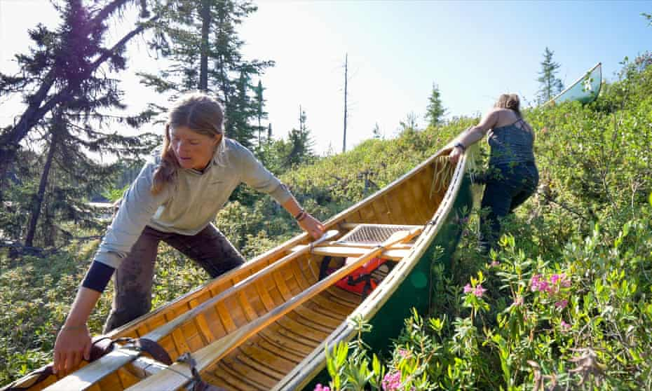 The trip used traditional wood-canvas canoes.