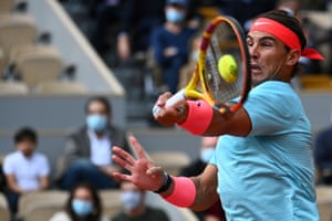 Rafael Nadal returns the ball to Diego Schwartzman.