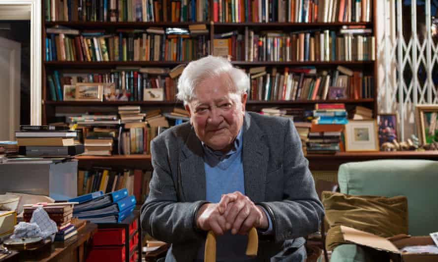 Richard Adams at home with his books in 2014.