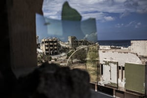 This photograph shows the view from where fighters of the Libyan forces remain out of sight from snipers and scan for possible targets at the frontline in Sirte