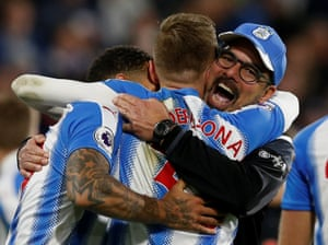Huddersfield Town manager David Wagner and players celebrate after defeating West Bromwich Albion 1-0 at the John Smith's Stadium.