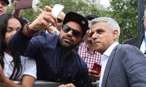 Mayor of London Sadiq Khan posing for a selfie during Eid celebrations in Trafalgar Square