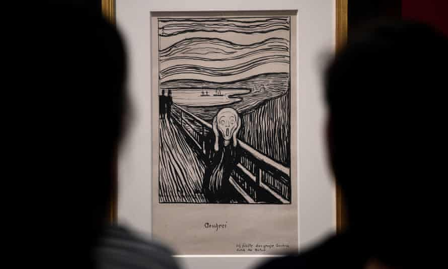 Art enthusiasts look at Edvard Munch's The Scream at the British Museum, London.