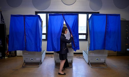 A voter leaves the booth after casting her ballot in the Pennsylvania