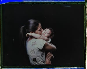 Angelica Pereira kisses her daughter Luiza. 'We are always chasing something. We have to drop everything else, all our chores, our homes,' said the 21-year-old. 'There are so many of us with children with special needs. (The government) is forgetting about that.'