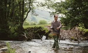 Nicholas Edwards, Lord Crickhowell, fly-fishing on a tributary of the River Usk to the rear of his home in Powys, Wales.