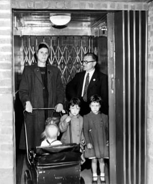 July 1951. Bert Turnbull, a lift attendant, looks on as some of his first passengers enter the pedestrian tunnel
