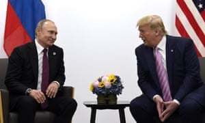 Donald Trump, right, meets with Russian president Vladimir Putin during a G-20 summit in Osaka, Japan on 28 June 2019.