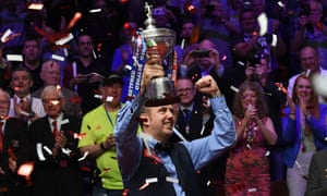 Mark Williams celebrates with the trophy after his victory.