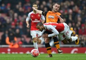 Arsenal's Theo Walcott is fouled by Hull City's Shaun Maloney.