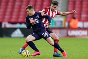 Bournemouth's Ryan Fraser looks to get the better of Sheffield United's George Baldock