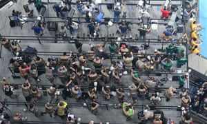 Overview shows photographers standing on a platform in front of the finish line of the 100m at the Olympic stadium of the Rio 2016 Olympic games
