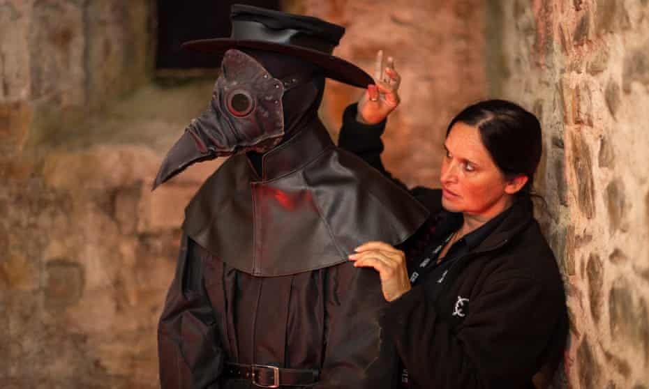 Kirsten Honey, the paranormal manager at Bodmin jail, adjusts a creepy artefact.
