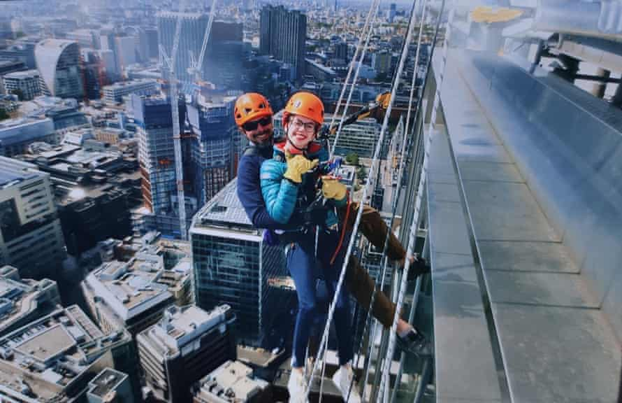 Grace Spence Green abseiling on a skyscraper