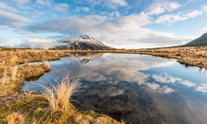 Reflection in Pouakai tarn of Mount Taranaki, referred to as a stratovolcano.