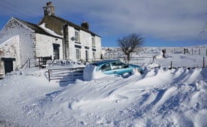 Drifting snow covers a car in Harwood in County Durham