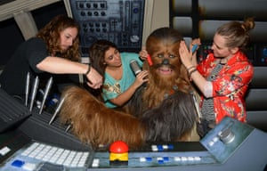 London, UK Members of staff makes last minute touch ups of wax figure Chewbacca, from Star Wars, on display at Madame Tussauds