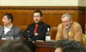 Dyab Abou Jahjah sitting next to Jeremy Corbyn's in 2009