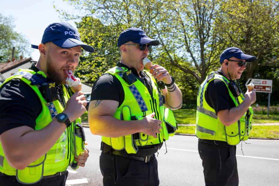 Officers enjoying ice-creams during the sweltering heat on Sunday.