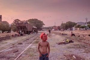 El Salvador: A Honduran child plays near train tracks in Arriaga, Chiapas, in southern Mexico, October 2018.