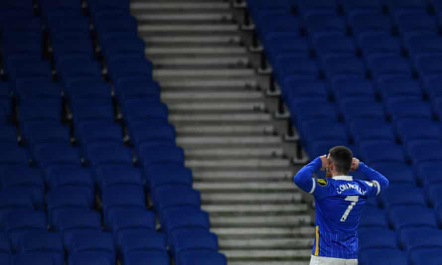 Aaron Connolly of Brighton celebrates in front of empty stands after scoring against Wolves