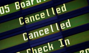 A board showing cancelled flights