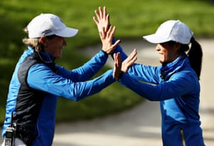 Celine Boutier of Team Europe celebrates with captain Catriona Matthew after winning in her match against Annie Park.