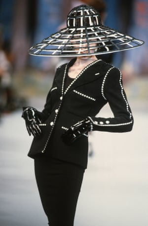 Hats off: a model pairs Chanel headwear with a classic skirt suit during the Spring/Summer 92/93 show