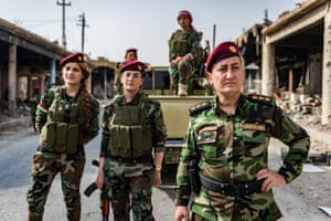 Peshmerga soldier Khatoon Khider, photographed with her all-female unit, Daughters of the Sun, in the Sinjar province of Iraqi Kurdistan.