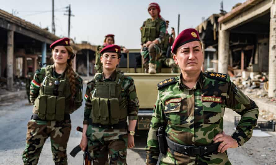Khatoon Khider, a Kurdish singer turned Peshmerga soldier, with her unit in Sinjar city.