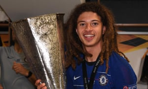 Ethan Ampadu celebrates with the Europa League trophy following Chelsea's win over Arsenal.