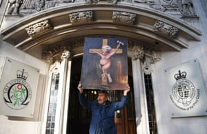 London, UK: The satirical artist Kaya Mar protests outside the supreme court after a hearing on the prorogation of parliament
