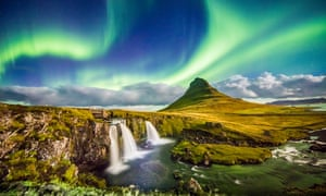 the aurora borealis over Kirkjufell and its waterfalls