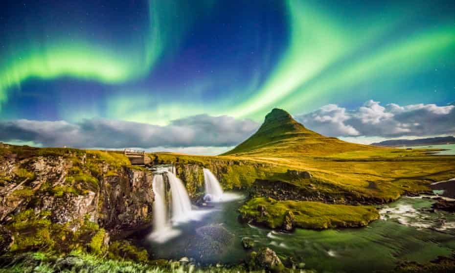 the aurora borealis over Kirkjufell and its waterfalls