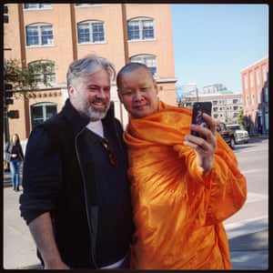 Guardian journalist Matt Teague has his photograph taken withSomboon Rattanawerapong, 47, a buddhist monk from Thailand who lives in Arlington, Texas,