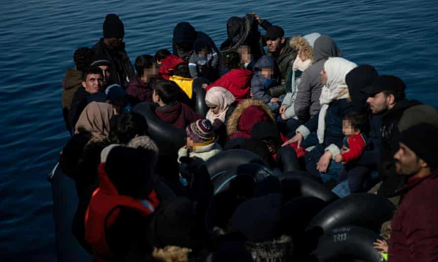 Migrants, who crossed part of the Aegean Sea from Turkey, are seen on a dinghy with a damaged engine, as locals prevent them from docking at the port of Thermi, on island of Lesbos, Greece.
