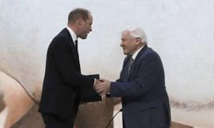 Prince William greets Sir David Attenborough on stage at Davos.