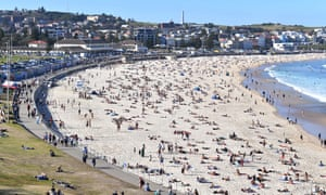 People crowd Bondi Beach as warm weather returns to Sydney, 30 August 2020.
