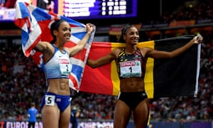 Nafissatou Thiam, right, of Belgium and Katarina Johnson-Thompson of Great Britain celebrate together after winning gold and silver.