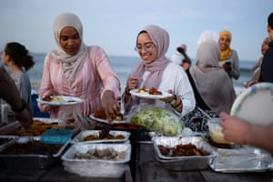 American Muslims take part in Iftar – the meal eaten after sunset during Ramadan – in New Jersey