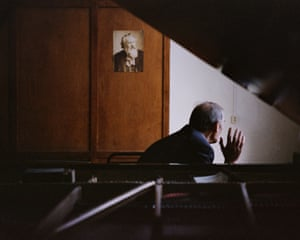 Vladimir Biryukov, president of the Siberian Piano Tuners Association, photographed in an organ practice room at the Novosibirsk Conservatory with an iconic Model D Cherry 1881 Steinway grand piano. Biryukov believed the Steinway came to Siberia for the Leningrad Philharmonic Orchestra when Lenigrad's top musicians, as well as some of the country's prima ballerinas, were evacuated to Novosibirsk for safekeeping during the Second World War.