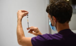 A healthcare worker handles a AstraZeneca COVID-19 vaccination inside of a vaccination centre at the Royal Exhibition Building in Melbourne.