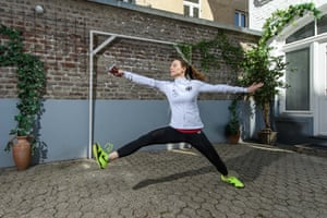 German fencer Anna Limbach trains in her back yard in Cologne.