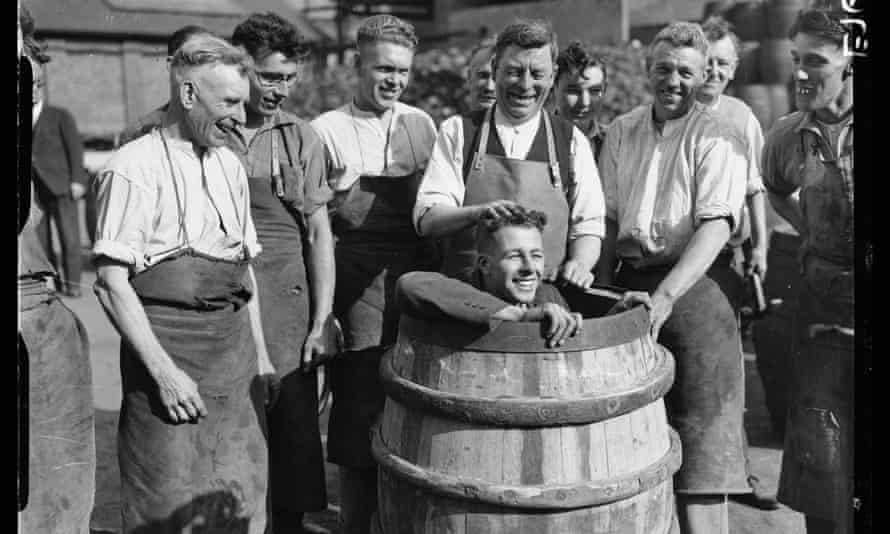 An apprentice cooper readies for an initiation ceremony at the brewery, then owned by the Watney family, in 1934.