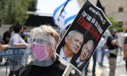 People protest in Jerusalem on Sunday against Benjamin Netanyahu, who is indicted on corruption charges, being prime minister.