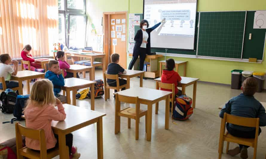 Pupils learn about physical distancing at a reopened school in Kranj, Slovenia