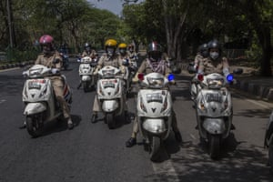 New Delhi, India Police women on mopeds patrol, as India remains under lockdown