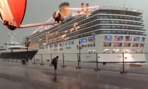 The cruise ship Costa Deliziosa sails dangerously close to a yacht in Venice during a thunderstorm on 8 July