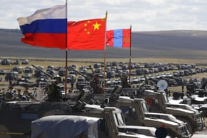 Russian, Chinese and Mongolian national flags are displayed on armoured vehicles