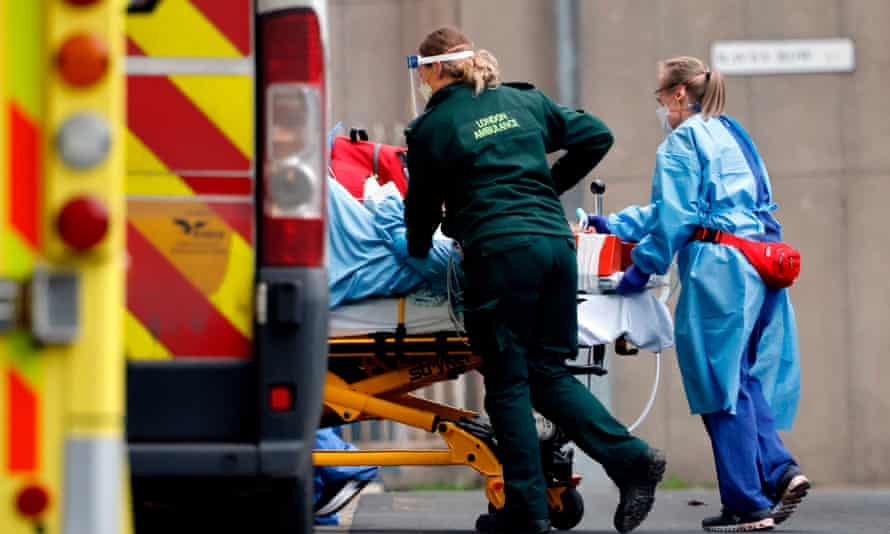 A patient is taken from an ambulance by staff at the Royal Free hospital in London